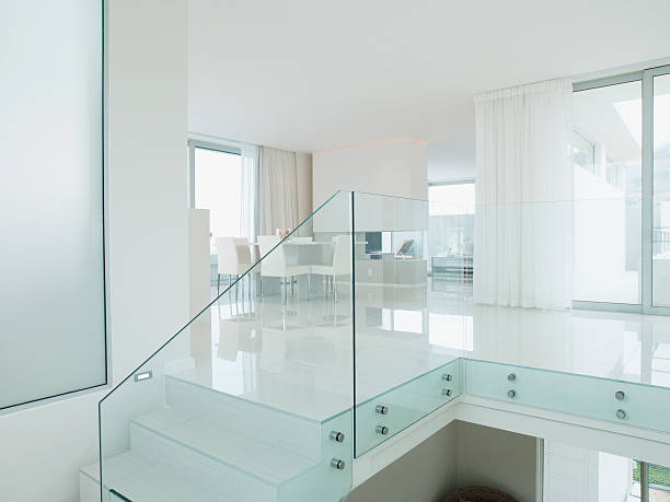 Staircase with glass railing in luxurious apartment stock photo