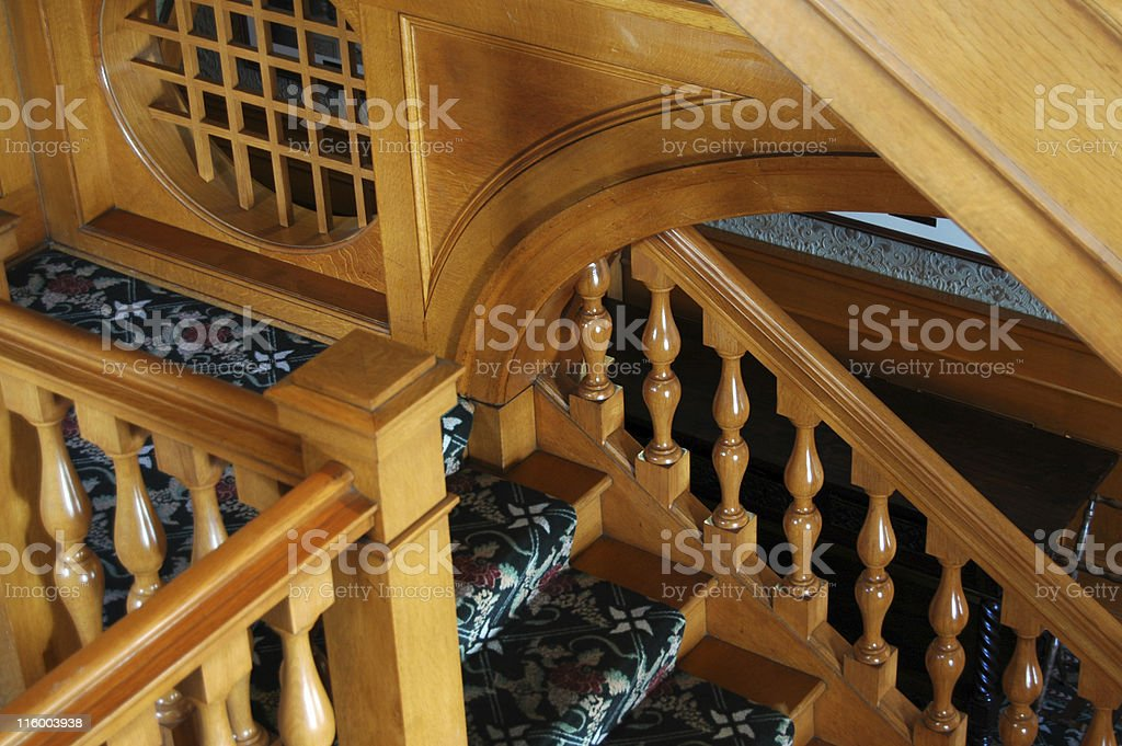 Polished mahagony staircase detail with ornate wood railing. Hayes...