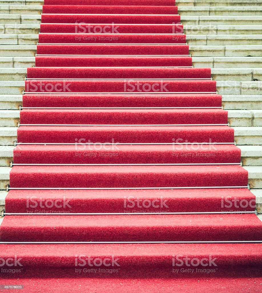Staircase with red carpet stock photo