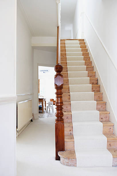 staircase with runner and empty hallway - carpet runner stock photos and pictures