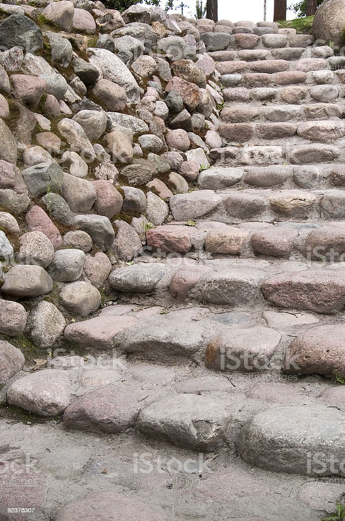 Stairs along a stone wall royalty-free stock photo