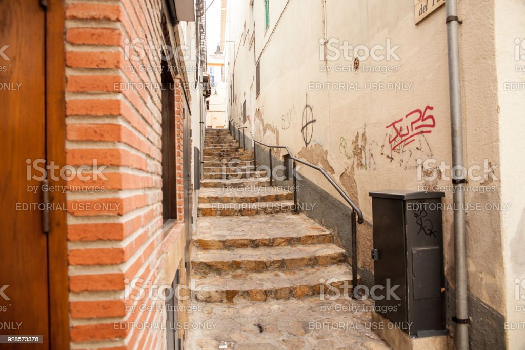 Stairs between houses near the narrow streets of Lloret de Mar. Downtown of Lloret, Spain. stock photo