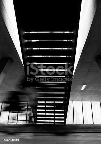 812812808istockphoto B&W stairs / crossing bicycle 994261338