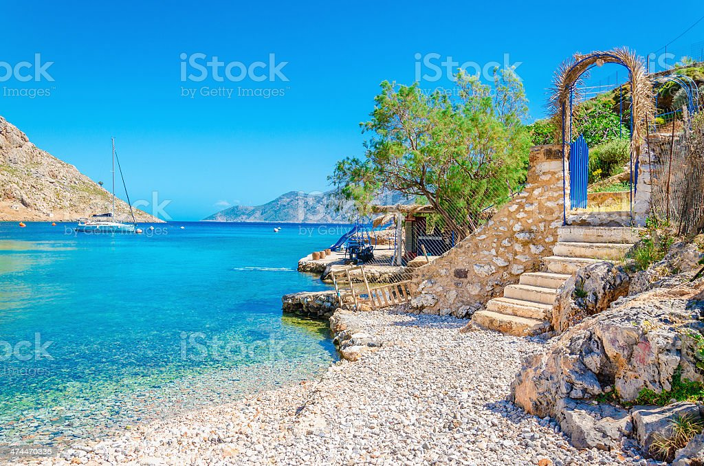 Stairs from sandy beach on Greece island Kalymnos stock photo