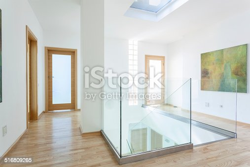istock Stairs, glass banister and doors in modern hallway 516809265