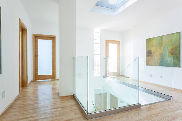 Stairs, glass banister and doors in modern hallway stock photo