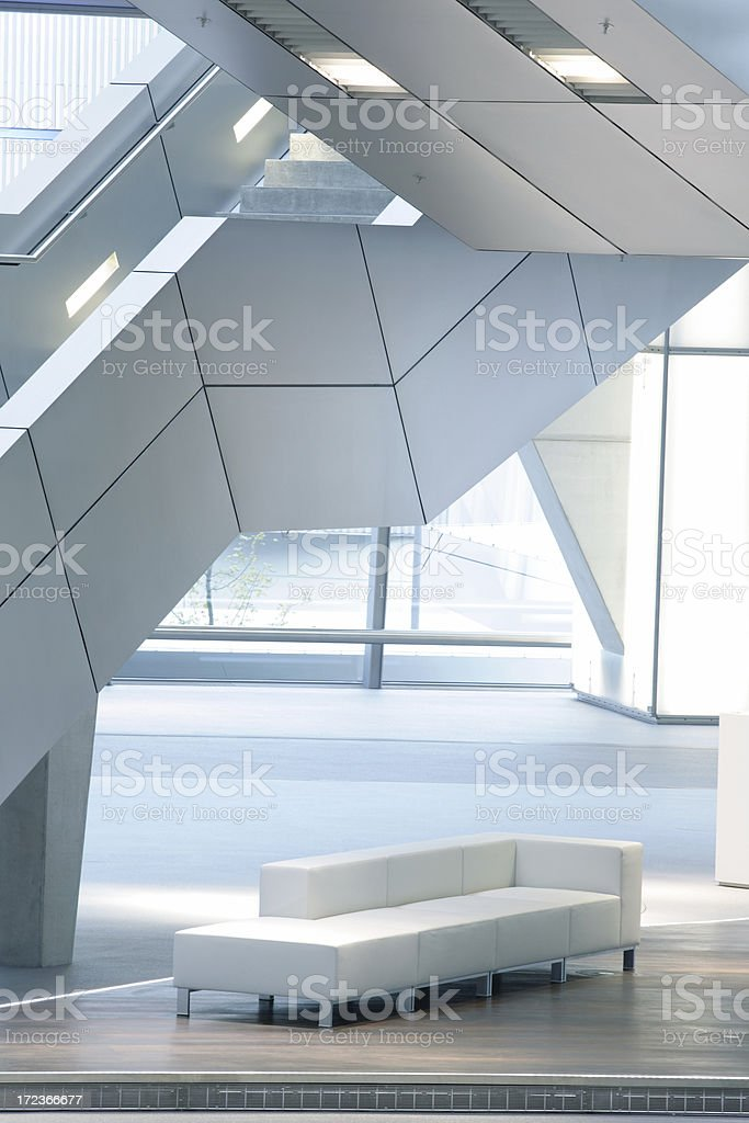 Stairs in Modern Interior, Illuminated Staircase and Sofa stock photo