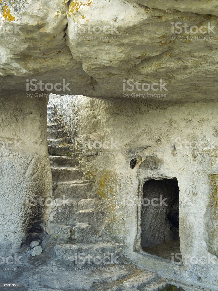 Stairs in stony cave house stock photo