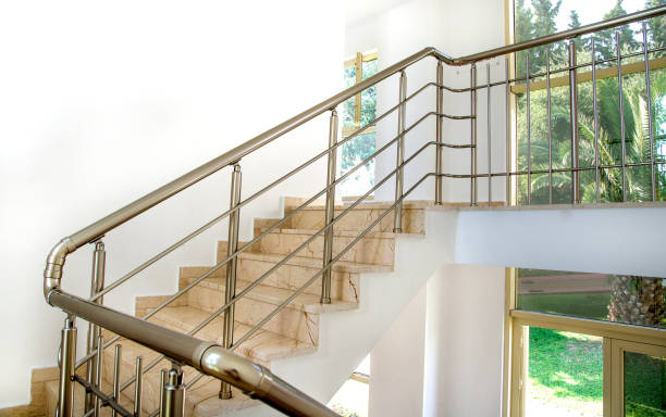 Stairs in the building with metal handrail stock photo