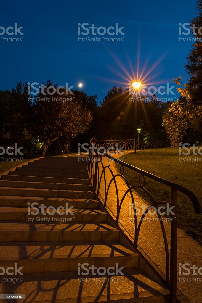 Stairs in the park at midnight stock photo