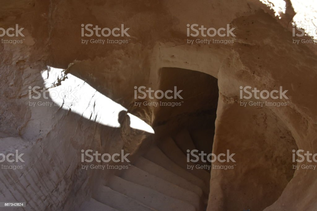 Stairs into a cave stock photo