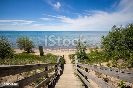 Waterfront park with a wide sandy beach on the shores of Lake Michigan in the downtown district of the Upper Peninsula city of Manistique Michigan.