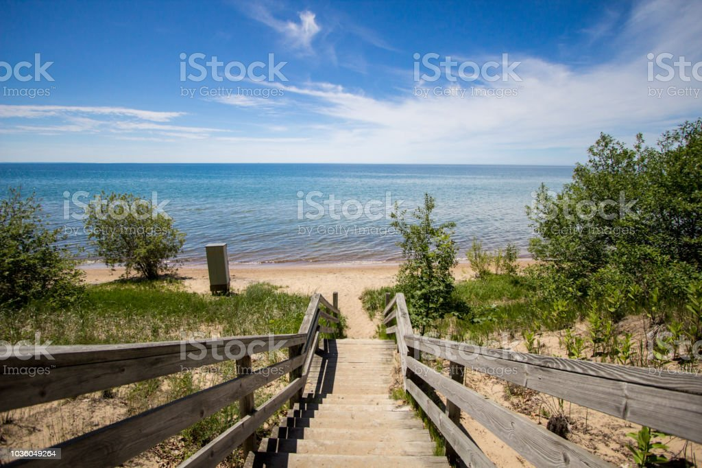 Stairs Lead To A Sunny Sandy Summer Beach On The Coast Of Great Lakes stock photo
