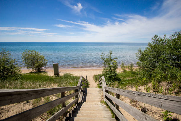 stairs lead to a sunny sandy summer beach on the coast of great lakes - lake michigan stock pictures, royalty-free photos & images