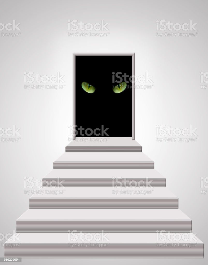 stairs leading to door with cat's eyes in darkness stock photo