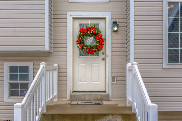 Stairs leading to front door with christmas wreath stock photo
