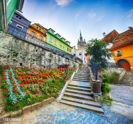 Stunning summer view of medieval city. Stairs leading to Sighisoara city and Clock Tower built by Saxons, Transylvania, Romania, Europe