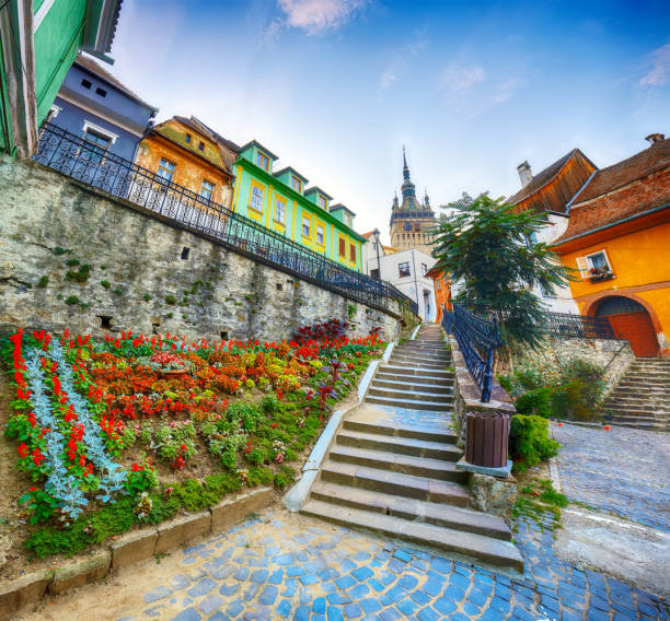 Stairs leading to Sighisoara city and Clock Tower built by Saxons stock photo