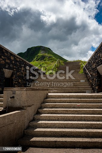istock Stairs leading up to the puy mary an old volcanoe ,auvergne, cantal France , landcape ,with cloudy sky ,walking ,adventure holiday. 1299559630