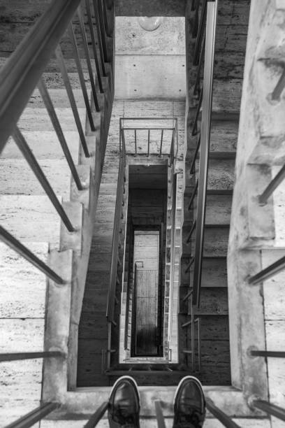 Stairs looking down with feet stock photo