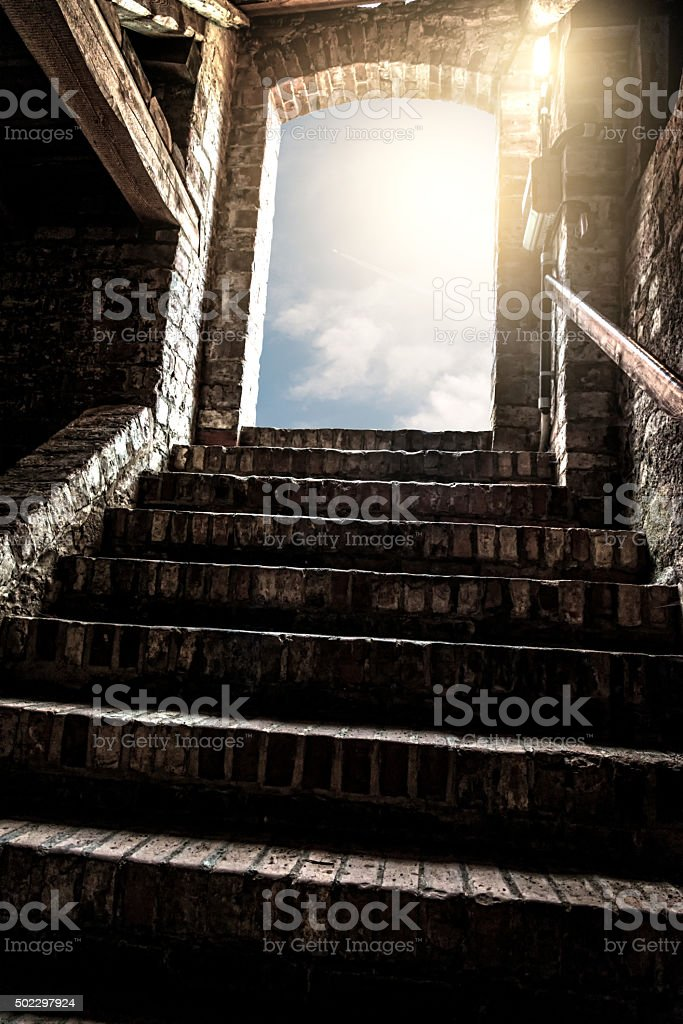 stairs of old room with shining light stock photo