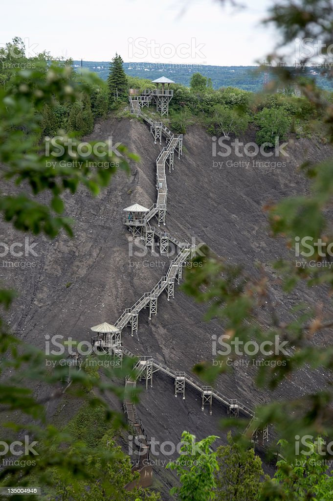 Stairs on the face of a steep slope royalty-free stock photo