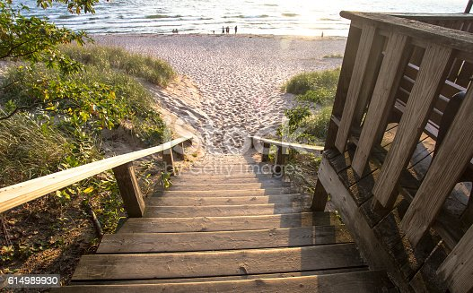 832047798 istock photo Stairs To A Wide Sandy Beach 614989930