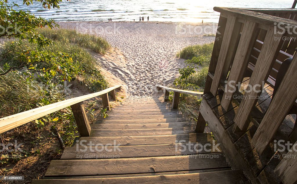 Stairs To A Wide Sandy Beach stock photo