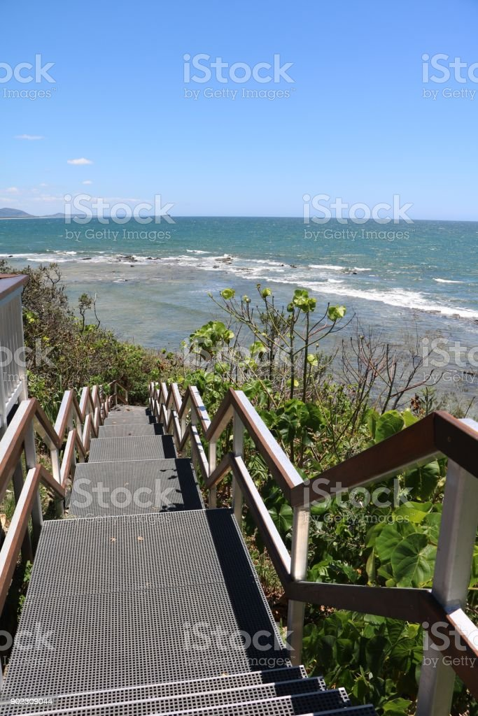 Stairs to beach of Sunshine Coast in summer in Queensland, Australia stock photo