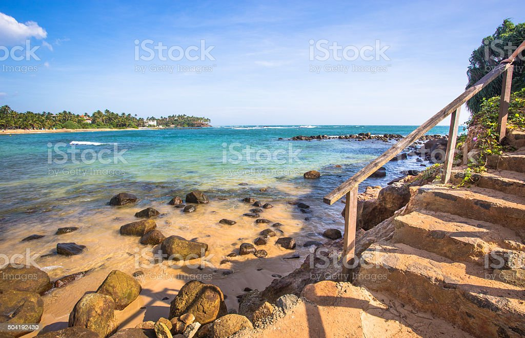 Stairs to ocean stock photo