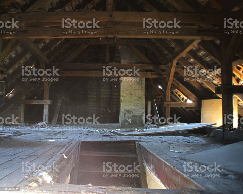 Stairs to the old wooden attic stock photo