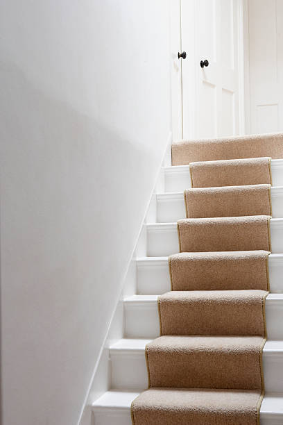 stairs with beige runner - carpet runner stock photos and pictures