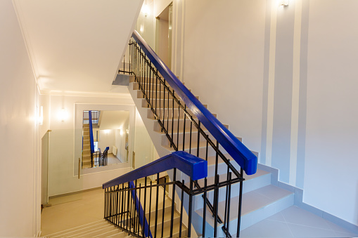 Stairs with mirror in the wall  is the part of interior of apartment after remodeling, renovation, extension, restoration, reconstruction and construction.