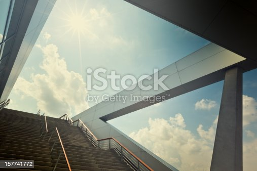 concept shot of a modern architecture surrounding with a huge stairway into the light.