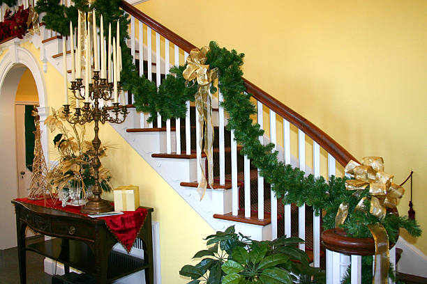 stairway ready for the holidays - christmas tree stockfoto's en -beelden