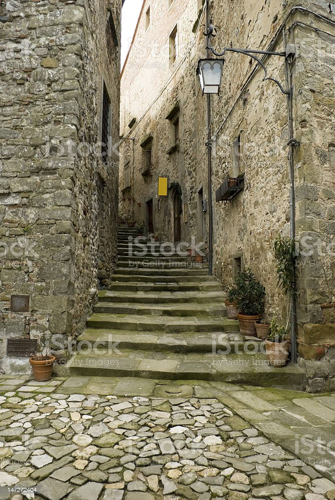 Stairway, stone and street lamp in a Tuscany village royalty-free stock photo