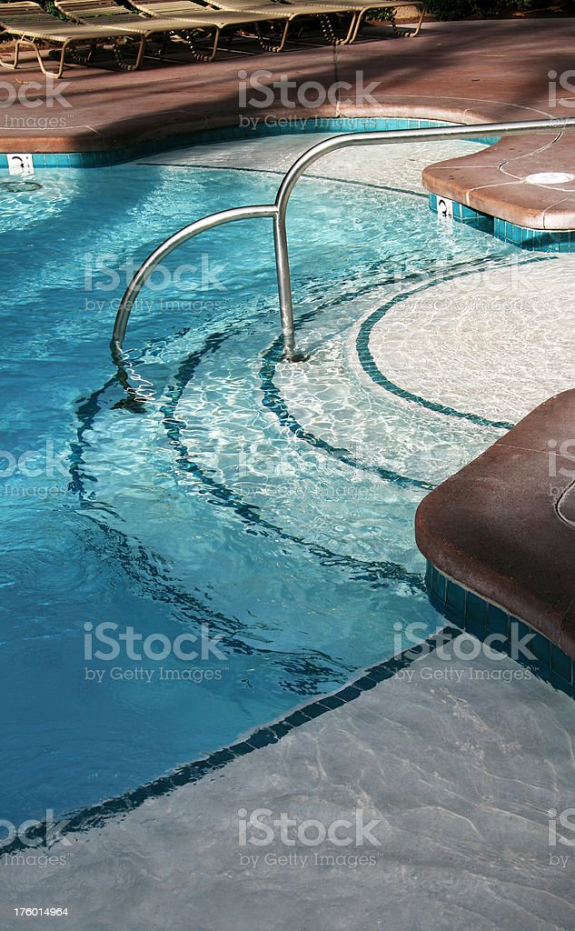 Stairway to enter swimming pool. royalty-free stock photo
