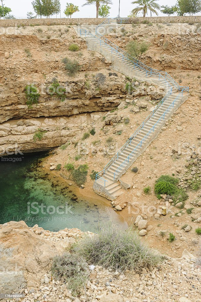 Stairway to the bottom of sinkhole royalty-free stock photo