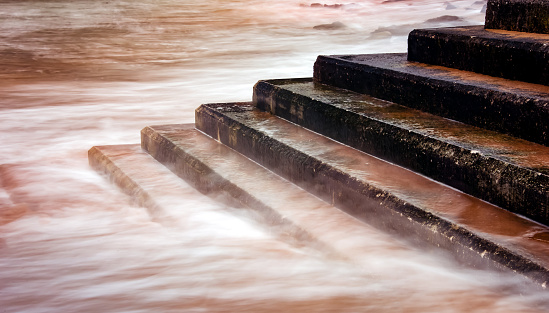 Long exposure photography, when the tide rises flooded the access stairs