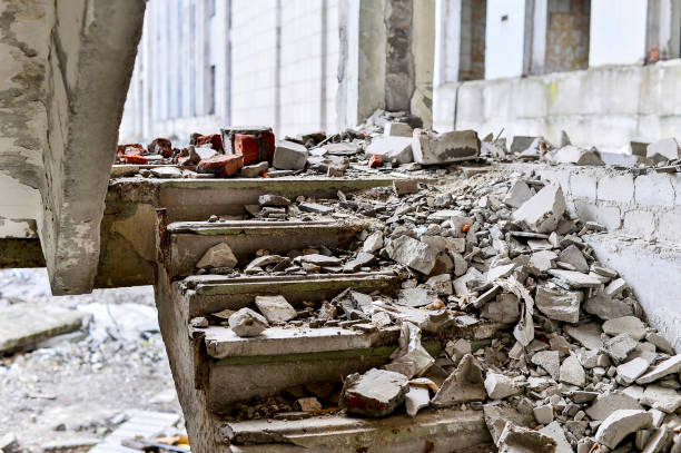 Stairwell concrete buildings littered with debris of stones and concrete Stairwell concrete buildings littered with debris of stones and concrete. demolishing stock pictures, royalty-free photos & images