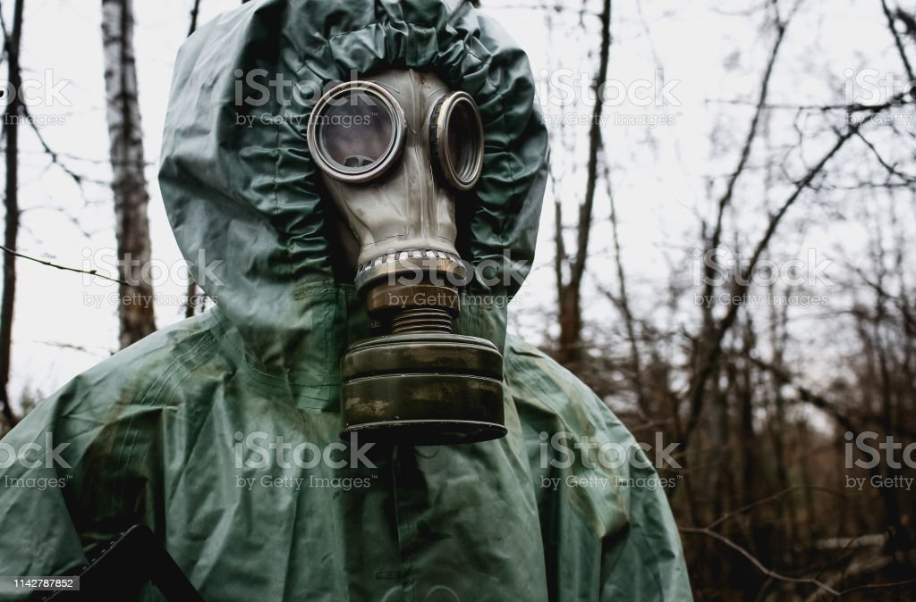 Stalker, a man in a gas mask and special chemical protection, green...