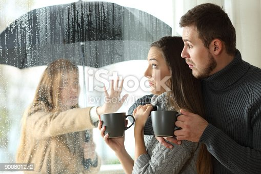 Stalker ex girlfriend disturbing to a couple that is relaxing looking through a window in a coffee shop