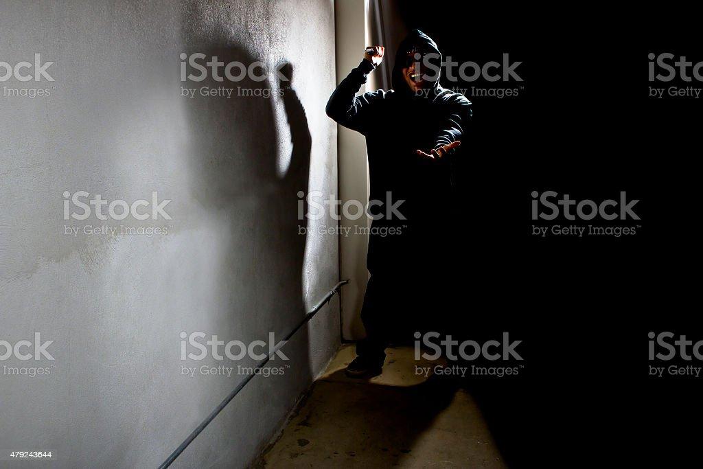 Stalker in a Dark Alley stock photo