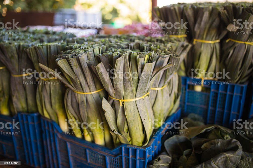 Stalks of leeks, green vegetables, local market produce in a box close up image. Top view. vegetarian, raw food, vitamins, healthy food stock photo