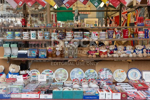 Stalls selling tourist souvenirs in the market in the city centre of Cambridge in England.