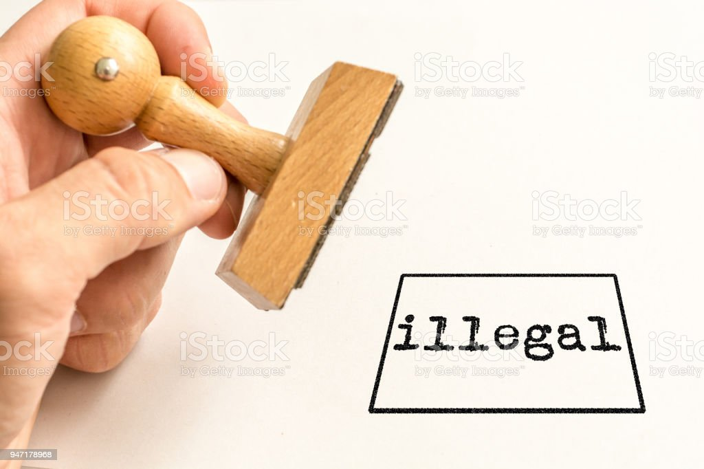 Stamp 'illegal' on a white background stock photo