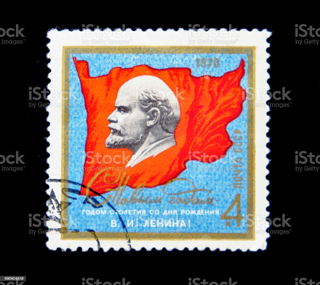 USSR - CIRCA 1970: A stamp printed in USSR shows Vladimir Ilyich Lenin portrait on a red flag, circa 1970 stock photo