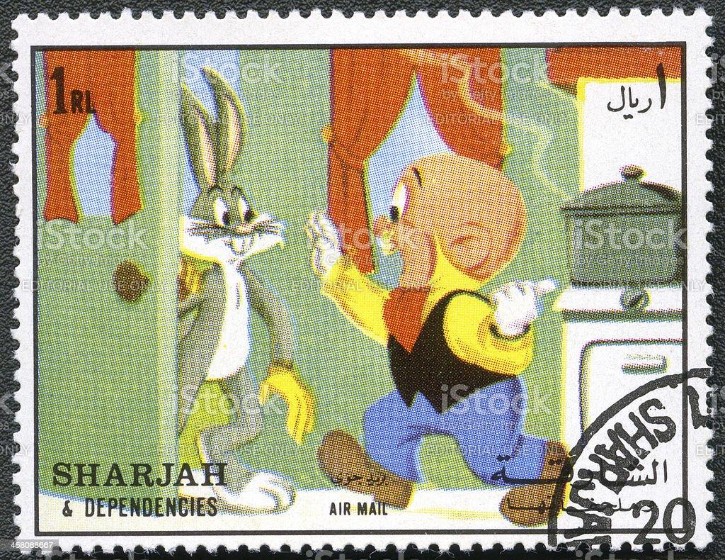 Stamp Sharjah & Dependencies Bugs Bunny Elmer Fudd, Warner Brothers 1972 stock photo