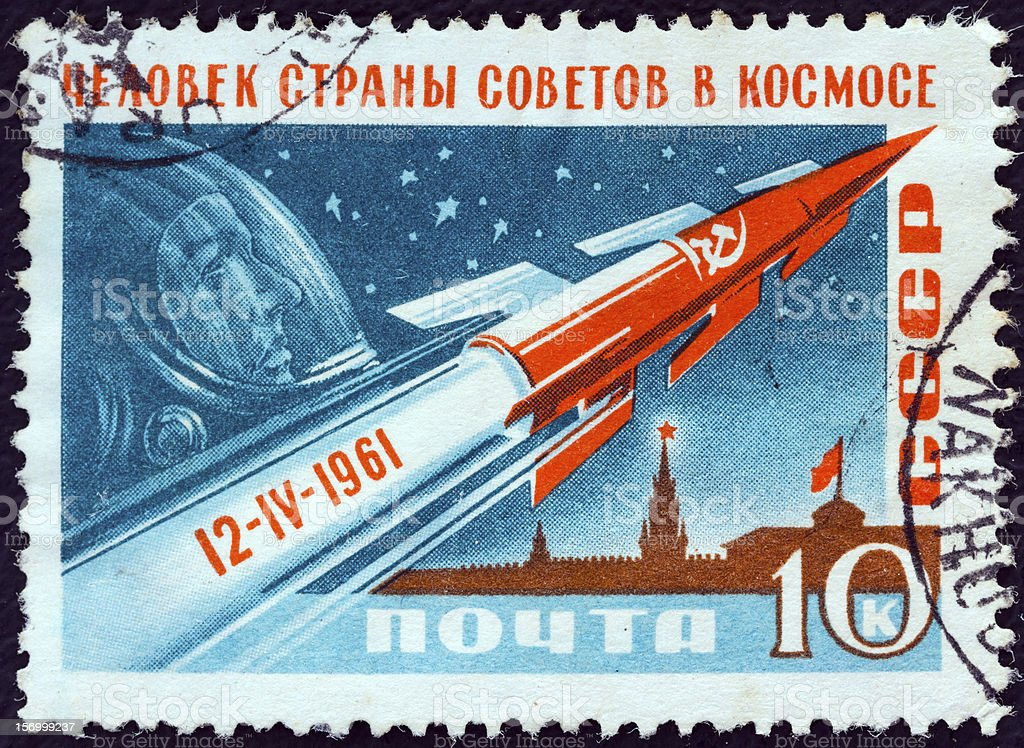 USSR stamp shows Rocket, Gagarin and Kremlin (1961) royalty-free stock photo