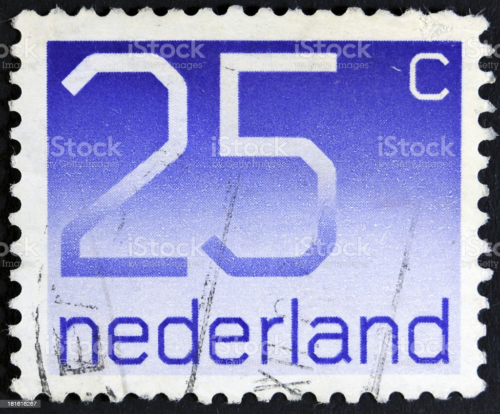Stamp with a value of twenty-five cents royalty-free stock photo